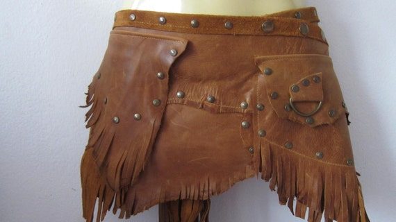 kick arse waxed rust tan leather skirt/belt with fringing,studs,pockets and d ring details...