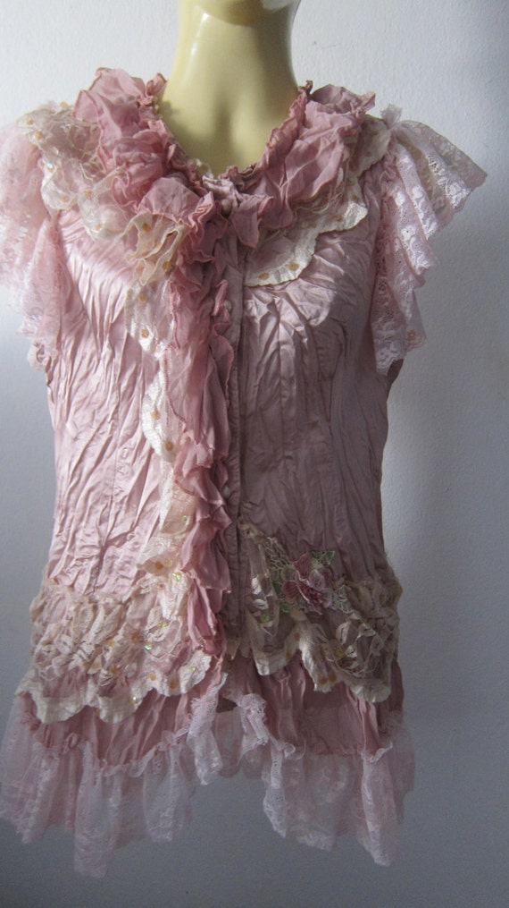 vintage inspired satin top with ruffles of lace and vintage motifs......