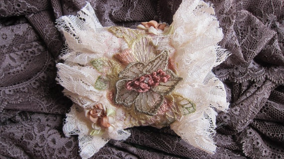 FREE POSTAGE...vintage cuff...leather lace  and vintage motif..
