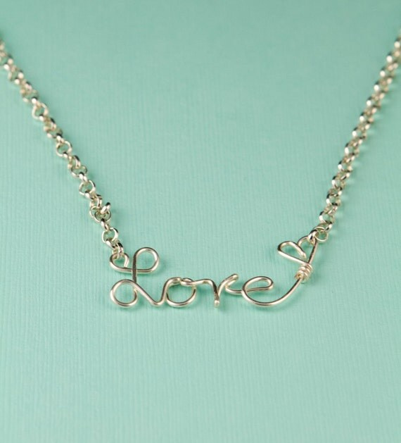 Custom necklaces with a word and a tiny heart. Custom wire word jewelry. Personalize this necklace with any word up to 8 letters.