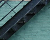 Black Metal Staircase with Teal Background, minimalist, simple, color blocks, blue, white, photograph