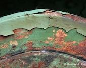 Green Peeling Paint Over a Rusty Mechanical Part, photograph
