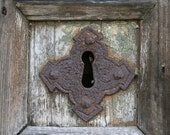 Rusty Keyhole on a Wooden Door, photograph