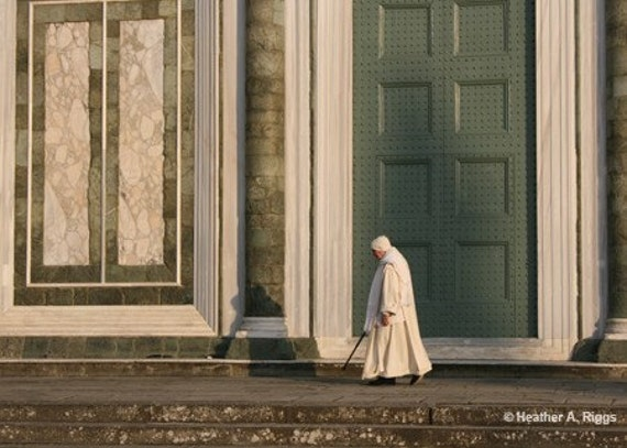 Monk Walking in Front of San Miniato al Monte, Florence, Italy, photograph