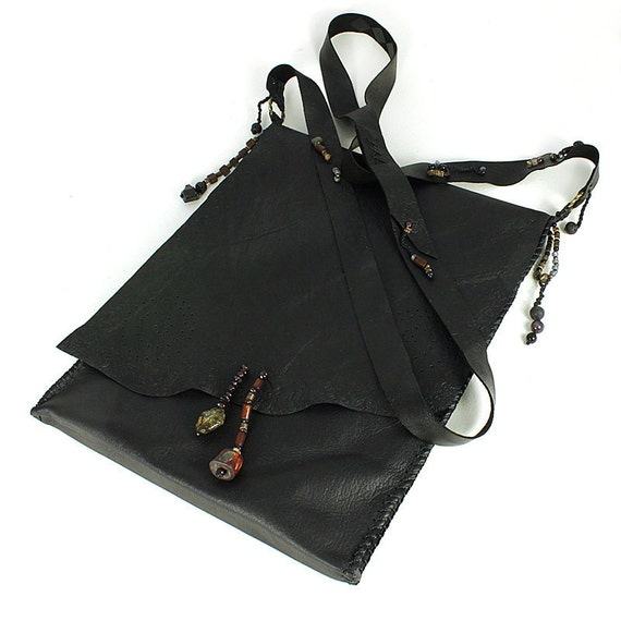 iPad case / iPad sleeve in black leather with shoulder strap, leather wrapper bag in style of talismanic medicine pouch