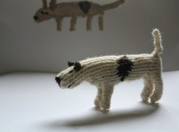 Little hand knitted patch dog