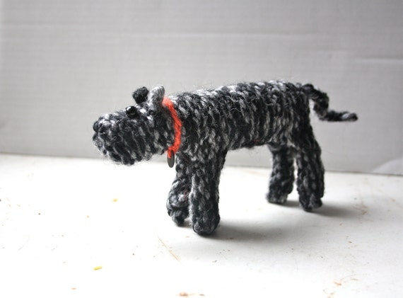 Small hand knitted dog
