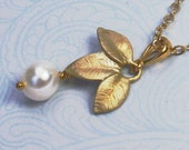 Labor Day Sale. Malka. gold and pearl leaf necklace.  With three leaves and a delicate tiny pearl