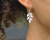 Beginnings. Tiny leaf earrings in silver simple everyday sweet