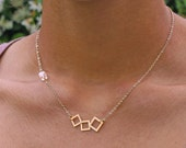 Wonky squares. Cube and squares necklace in gold with clear Swarovski crystal chain necklace (NM-244)