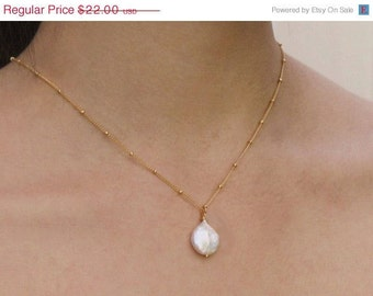 Freshwater coin pearl necklace with delicate chain in gold. Mothers Day