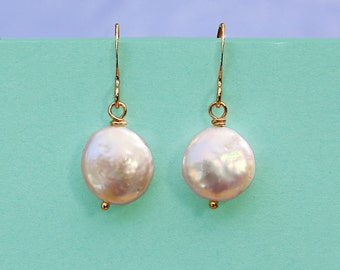 Simple coin pearl  earrings in gold with a  freshwater pearl