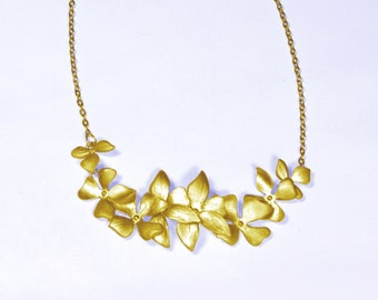 Flower necklace. Wild orchid flower  Necklace in gold with 8 flowers Bridal weddings bridal chain necklace