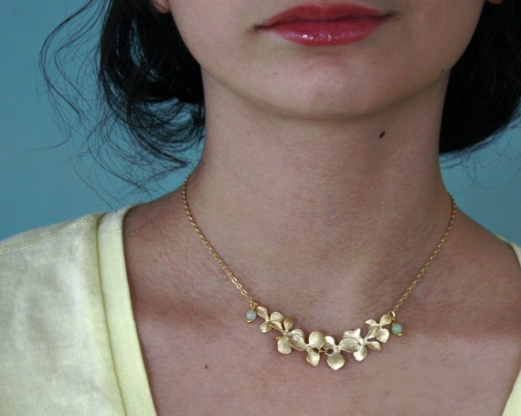 Six Orchid Flower Necklace. Gold plated with green gemstones