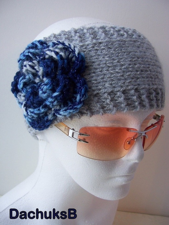Gray hand knitted headband ear warmer with crochet flower in blue shades