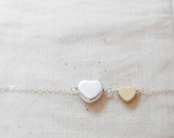 Melissa, Friends (necklace) - Tiny 14k gold plated puffed heart and small sterling silver puffed heart