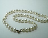 Faux White Pearl Necklace by W Lind