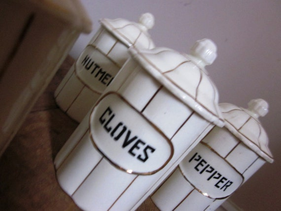 Set of Six Vintage Ceramic Spice Canisters Gold and White