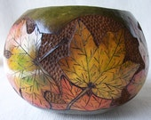 Wood burned and carved gourd bowl with fall colored maple leaves. 1533.