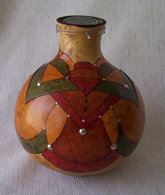 Fat cutneck gourd box with wood burned patterns and silver nail head accents on aluminum wire base.  Item 1361.