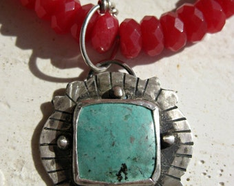 square turquoise stone with bright faceted red jade stone beads