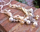 Ivory ribbon and pearl necklace with chain and rhinestones