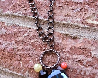 Teal faceted bead with coral, yellow, black and gray beads on gunmetal chain