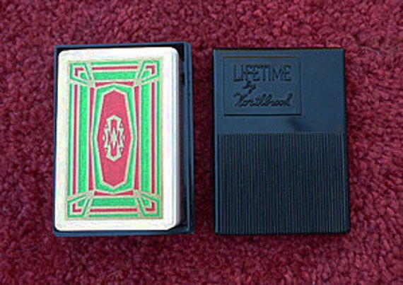Art Nouveau gold and red  Playing Cards in 50's black plastic case