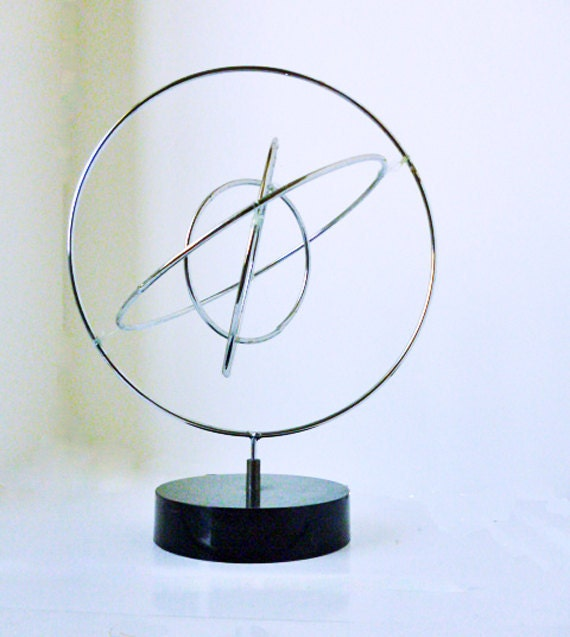 Atomic signed kinetic sculpture by John W. Anderson