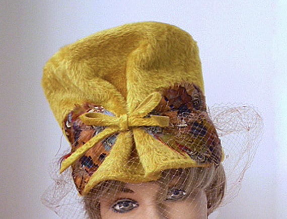 1960's gold fur velour hat with feathers and net