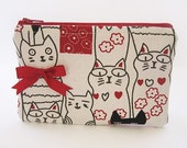 A Cat Fanatic's Zip Pouch featuring a Cute Ribbon Bow (Red)