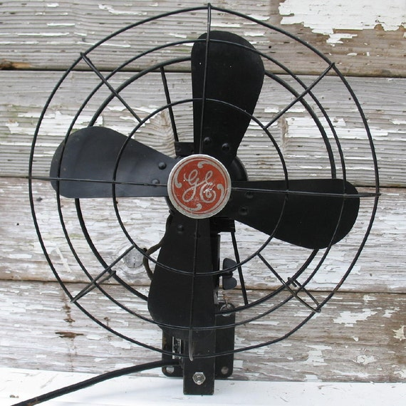 Black Wall Mounted Oscillating Fan : Vintage ge fan wall mounted black by ifindubuy on etsy