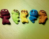 A set of five colorful wool felted ugly cute dancing robots....
