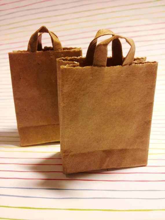 A set of  2 miniature brown paper  bags.
