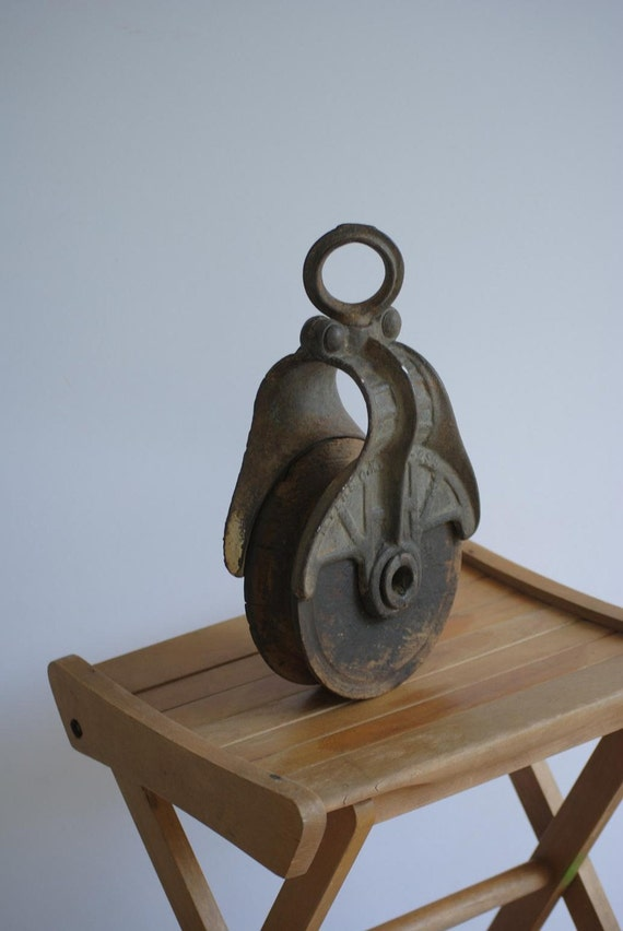 vintage industrial iron and wood barn pulley