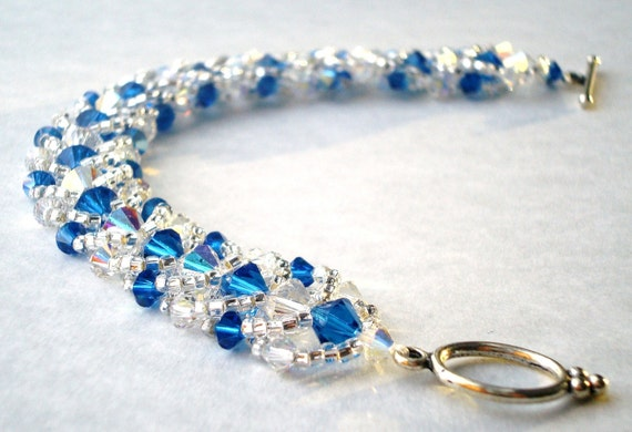 Woven bracelet Genuine Swarovski Blue and White crystal edged sterling silver toggle clasp