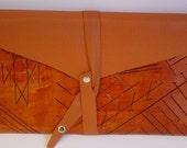 carved leather envelope clutch