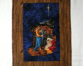 Quilted nativity embroidered stars and woodlike border