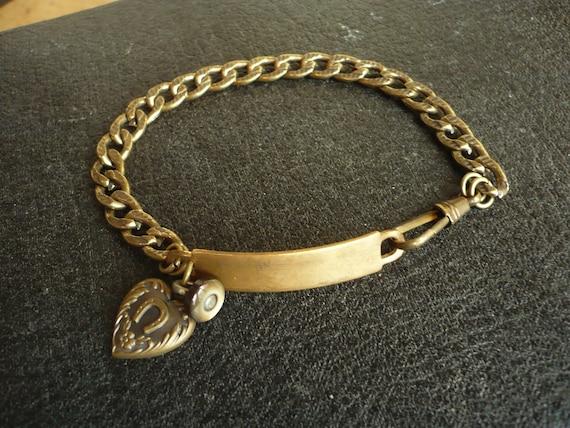 Bracelet id lucky heart vintage assemblage.  Lucky Charm bracelet.