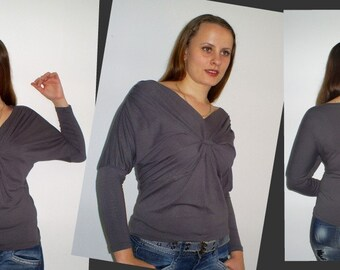 Grey blouse with draped on his chest and shoulders