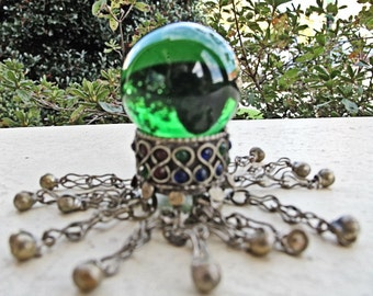 Tribal Bell Ring with 12 Dangling Bells Supporting a Green Glass Sphere