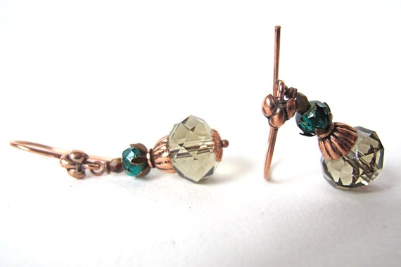 shiny glass beads in green-blue and a sort of grey with copper