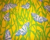 Vintage blue butterflies on bright yellow and green fabric