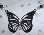 Aporia Butterfly Necklace with black and white glass beads