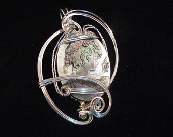 Pendant: Lovely naturally colored shell cameo, beautifully wire wrapped in sterling silver wire