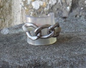ring, tranparent rubber and old silver gold chain ring