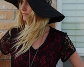 Black woven floppy hat with brown leather band