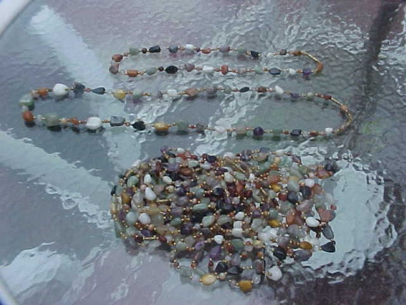 VINTAGE BEGGAR BEAD Necklace of assorted stones 24 inches long from India