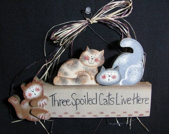 Three Spoiled Cats Live Here