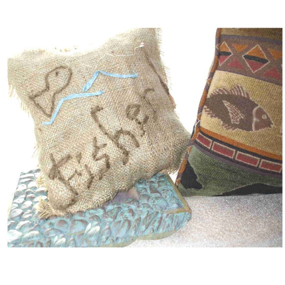 """part of the """"er"""" line... burlap and cotton reversible head cushions, 7 by 7 inches"""